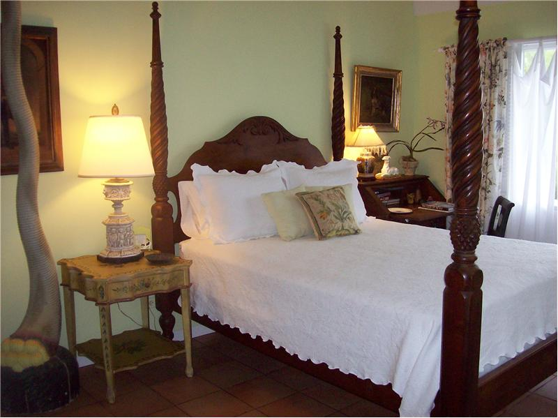 Classic, Tropical Furnishings in Guest Cottage Master Bedroom