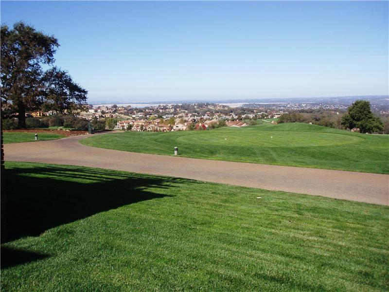 View from the golf course of Folsom Lake, Serrano homes, and El Dorado Hills